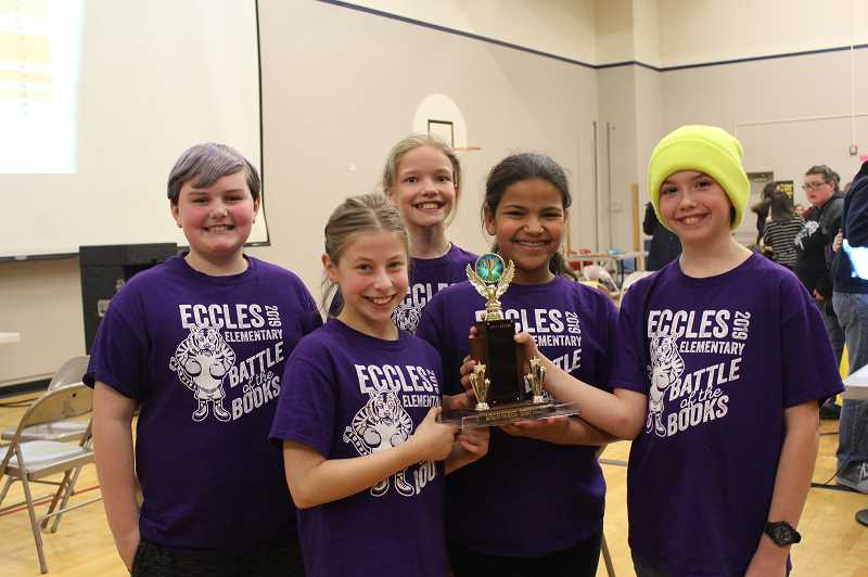KRISTEN WOHLERS - The 'Traumatized Turtles'; from Eccles Elementary School come away from the 3rd-5th grade district OBOB tournament with the trophy. The students are, from left to right: Harley Baxter, Hayden Wojack, Nona Chernishov, Sadye Taylor and Brendan Snyder.