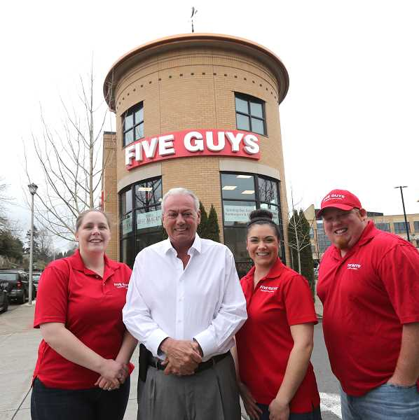 PMG PHOTO: JAIME VALDEZ - Five Guys Owner Bill Marble and his staff at the West Linn location.