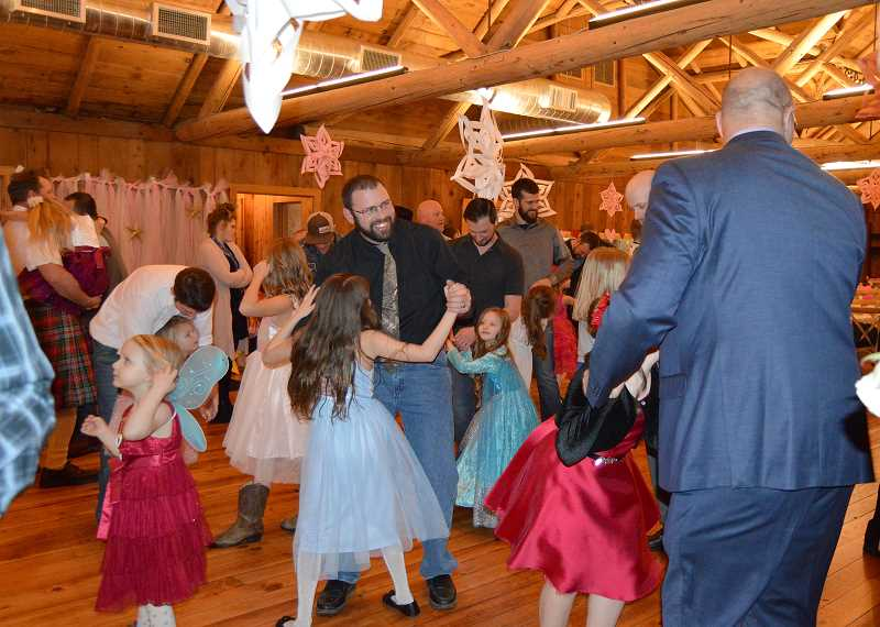 CINDY FAMA - Daddies and daughters dance the night away.