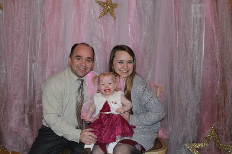 CINDY FAMA - Father Brent, baby sister Maija and event organizer Mikaela Bjorn pose at the photo booth.