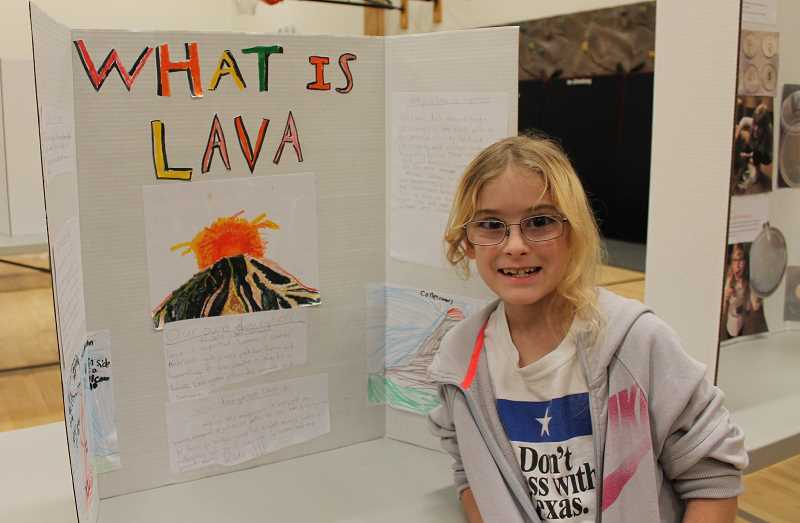 PMG PHOTO: HOLLY BARTHOLOMEW - Lowrie third-grader Arden Hyatt presents her science project about lava.