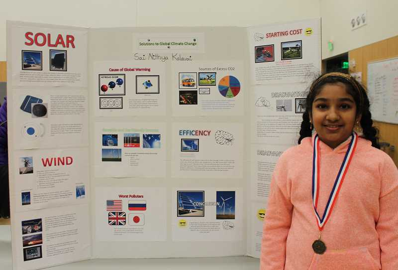 PMG PHOTO: HOLLY BARTHOLOMEW - Fourth-grader Sai Nithya Kalavai presents her own solutions to climate change at Lowries science fair.