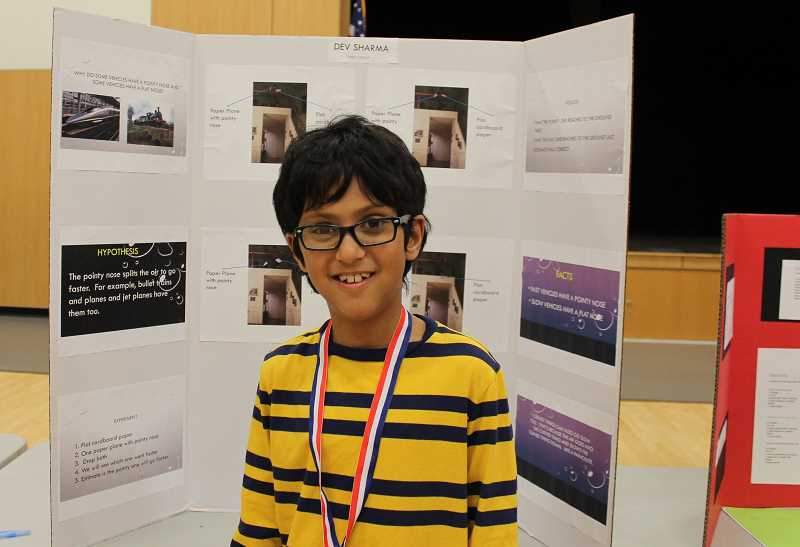 PMG PHOTO: HOLLY BARTHOLOMEW - Lowrie fourth-grader Dev Sharma explored the aerodynamics of vehicles for his science fair project.