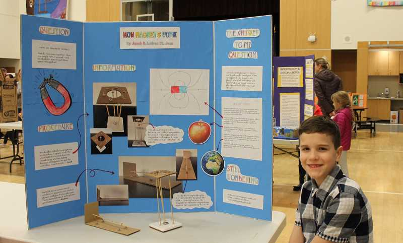 PMG PHOTO: HOLLY BARTHOLOMEW - Lowrie fifth-grader Jacob St. Jean presents his science fair project about the functions of magnets.