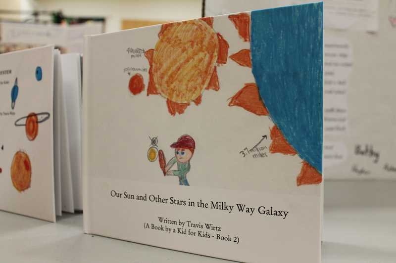 PMG PHOTO: HOLLY BARTHOLOMEW - Travis published his second book, Our Sun and Other Stars in the Milky Way Galaxy, in third grade.