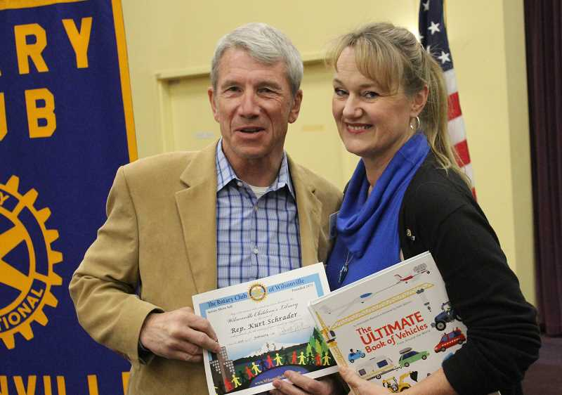 SPOKESMAN PHOTO: COREY BUCHANAN - Congressman Kurt Schrader poses for a photo with Rotary Club of Wilsonville President Laura LaJoie-Bishop.