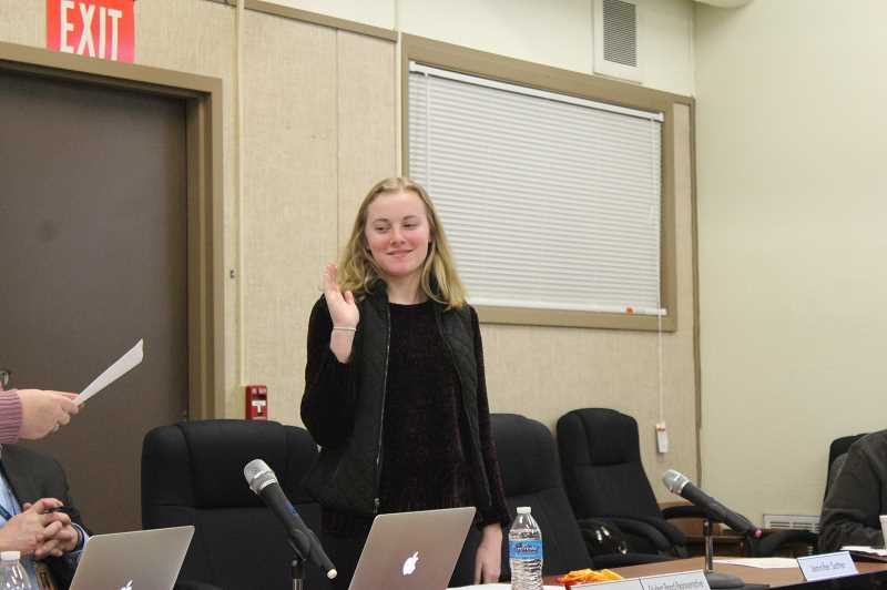 KRISTEN WOHLERS - MHS representative to the board Jaden Beyer is sworn in at the February regular meeting.
