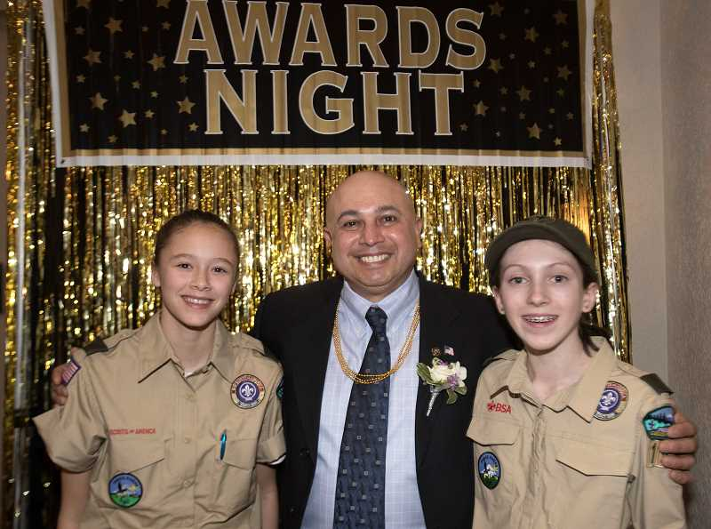 PMG PHOTO: JAIME VALDEZ - John Budiao was named the winner of the First Citizen Award at the Stars of Giving: The 2019 Heart of Gold Dinner and Auction last Saturday, Feb. 23 at the Wilsonville Holiday Inn. Pictured with Budiao is Talia Valdez, left, and Reagan Harms, who recently became Scouts in Troop 194.