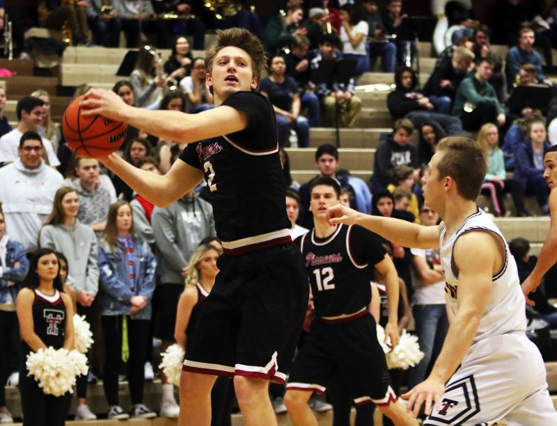 PMG PHOTO: DAN BROOD - Sandy junior Colby Carson (left) looks to get the ball inside during the Pioneers' state playoff win at Tualatin on Tuesday.