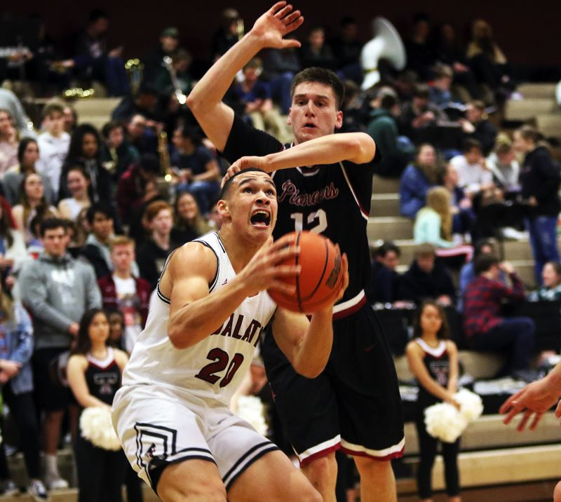 PMG PHOTO: DAN BROOD - Tualatin junior John Miller (front) looks to go up to the basket against Sandy's Colton Gorski during Tuesday's Class 6A state playoff game.