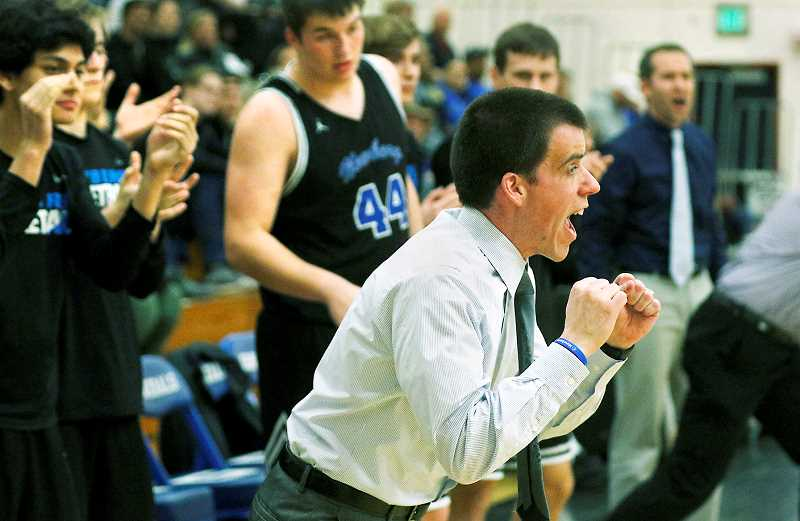 PMG PHOTO - NHS coach Mark Brown instructs his team during a 95-61 loss to Grant on Tuesday.