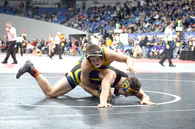 HERALD PHOTO: TANNER RUSS - Colton's Joseph Moore battled it out at the state tournament with the best 2A/1A.