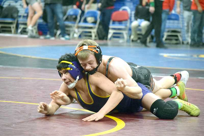 PIONEER PHOTO: TANNER RUSS - Molalla's Dustin Asher took fourth place in the tournament at 106 pounds.