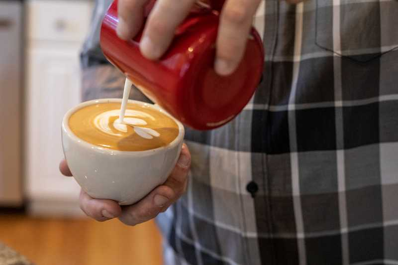 PMG PHOTO: JONATHAN HOUSE - Zach Perkins finishes off creating a latte at his home in West Linn.
