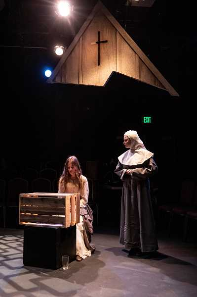 PMG PHOTO: JONATHAN HOUSE - Ashley Yablonsky, playing Isabella, left, and Grace Heaton, playing Francisca, rehearse for the WLHS production of 'Measure For Measure.'