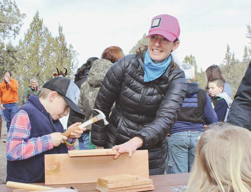 HOLLY M. GILL/MADRAS PIONEER - Holly Pearson, of Madras, helps her son, Jordan, 6, build a bird house.
