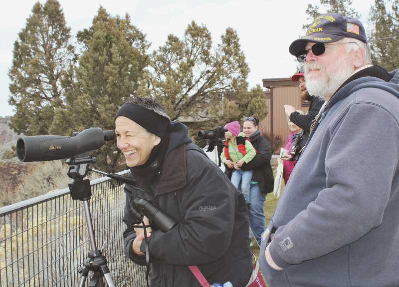 HOLLY M. GILL/MADRAS PIONEER - Kim and Larry Pearcy, of Terrebonne, have only missed one Eagle Watch in the event's 24-year history. The two check out the eagles in the Deschutes River canyon on Saturday, Feb. 23. The second day of the event, Feb. 24, was canceled, due to snow.