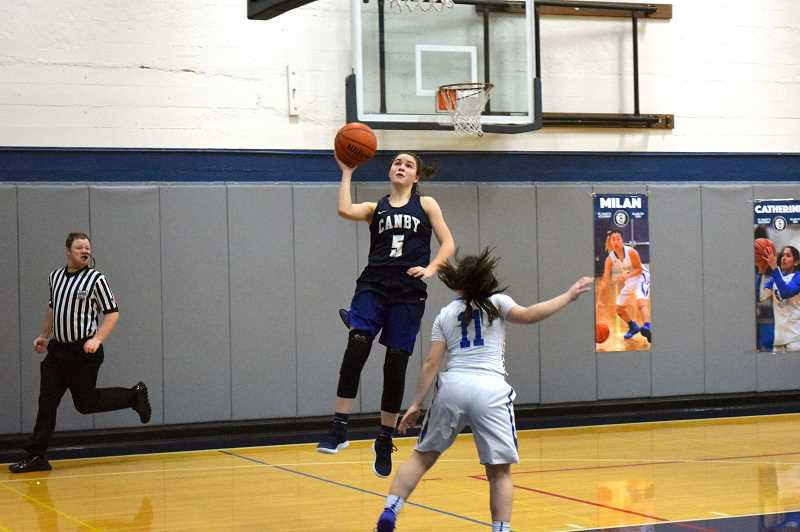 HERALD PHOTO: TANNER RUSS - Canby freshman Joey Baguio hits a jump shot against St. Mary's.