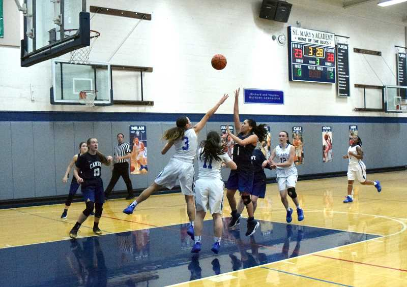 HERALD PHOTO: TANNER RUSS - Canby junior Naarai Gomez hits a floater from the top of the key against the St. Mary's Blues.