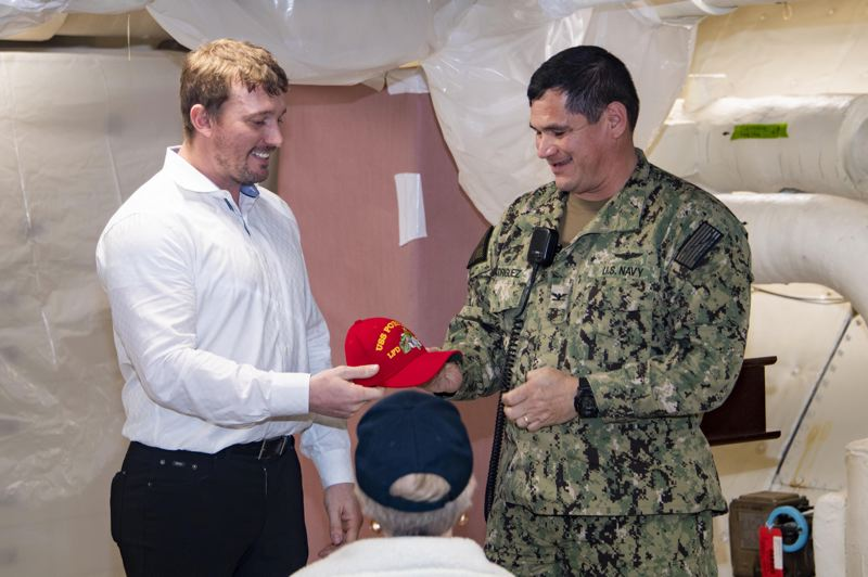 U.S. NAVY PHOTO/MASS COMMUNICATION SPECIALIST 2ND CLASS BRITNEY ODOM - Medal of Honor recipient Dakota Meyer receives a command ball cap from the Commanding Officer Capt. Jesus Rodriguez after his visit to amphibious landing dock ship USS Portland (LPD 27), for a question and answer session with Sailors and Marines.  Portland is currently pier side San Diego during her Post Shakedown Availability phase.