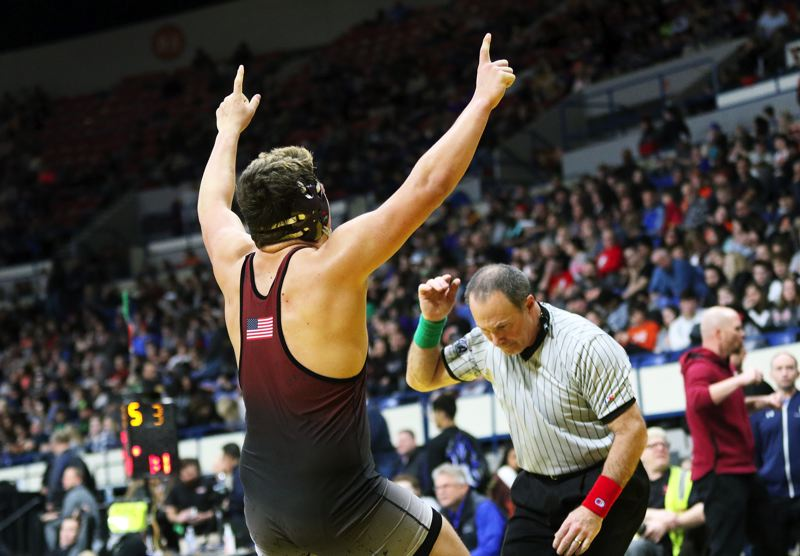 PMG PHOTO: DAN BROOD - Sherwood sophomore Bryan Cuthbertson celebrates following his 220-pound semifinal victory at the Class 6A state wrestling tournament.