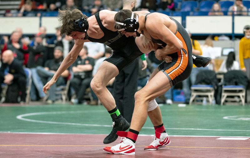 PAMPLIN MEDIA GROUP: LON AUSTIN - Scappoose's Colton Frates (right) wrestles at 122 pounds against Zachary Maurus of Crook County during the Class 5A tournament in Portland.
