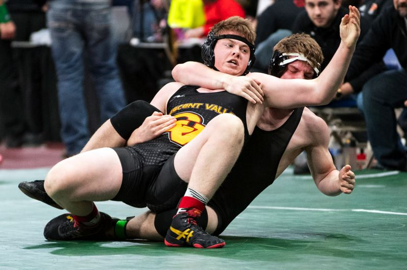 PAMPLIN MEDIA GROUP: LON AUSTIN - Mavrick Rask (right) of St. Helens works over his 182-pound opponent during the Class 5A championships last week at Veterans Memorial Coliseum.