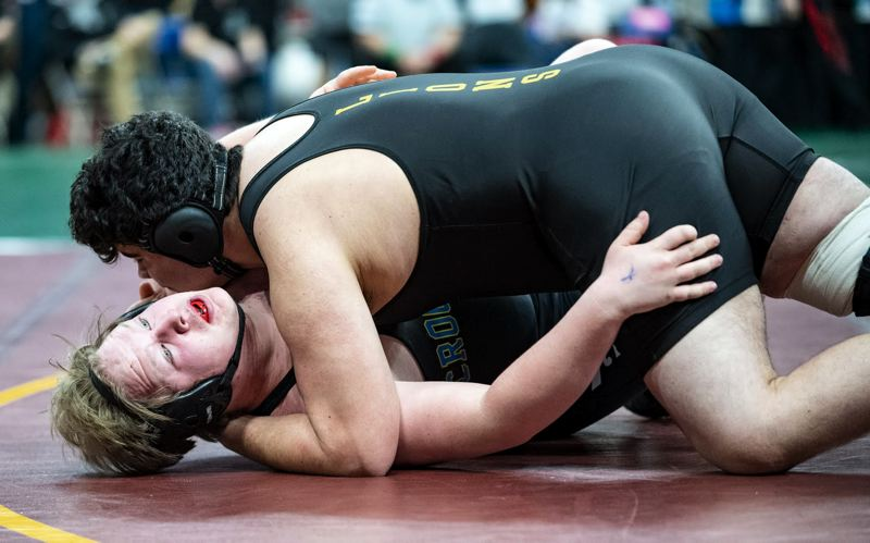 PAMPLIN MEDIA GROUP: LON AUSTIN - In the 285-pound division, Ben Torres (top) of St. Helens battles an opponent at the state tourney.