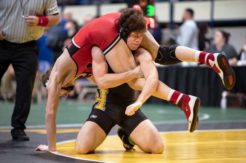 PAMPLIN MEDIA GROUP: LON AUSTIN - Rachawn Lee of St. Helens lifts his opponent in a 160-pound match at state