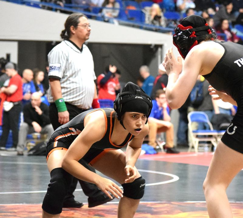 PAMPLIN MEDIA GROUP: TANNER RUSS - Bella Amaro of Scappoose High wrestles in the 125-pound division on her way to third place in the state girls championship at Veterans Memorial Coliseum.