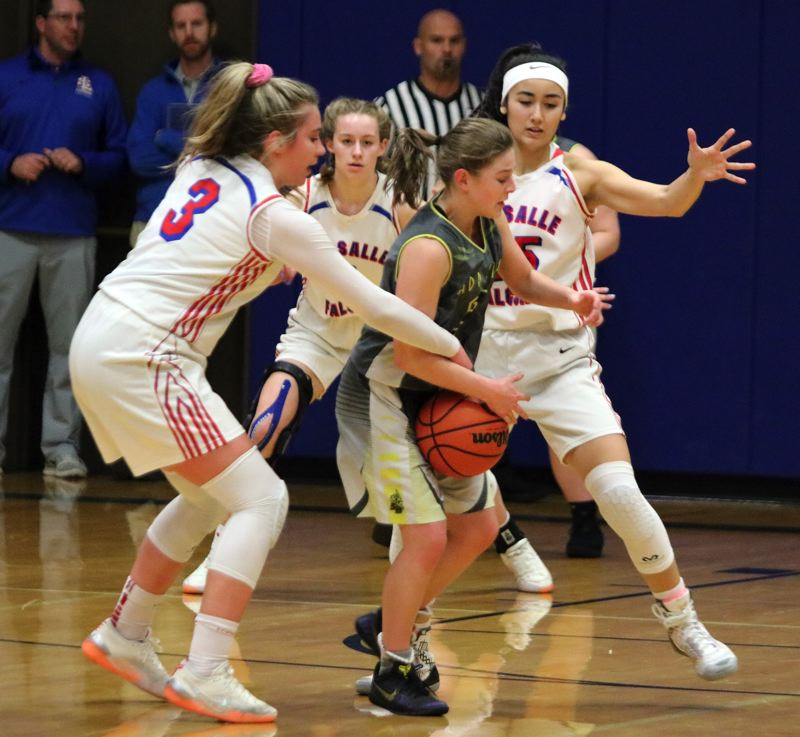 PAMPLIN MEDIA GROUP: JIM BESEDA - St. Helens Maria Reardon has the ball poked away by La Salle Preps Addi Wedin (left) as the Falcons' Alyson Miura applies more defensive pressure from the other side during Tuesday's game at La Salle Prep.