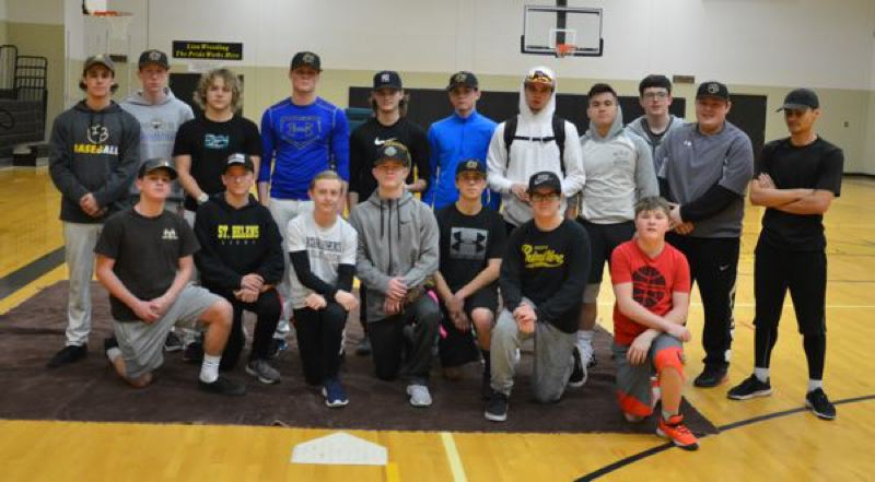 COURTESY: JOHN BREWINGTON - Baseball players trying out at St. Helens High take a break from an indoor practice session.