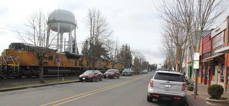 PMG PHOTO: JUSTIN MUCH - With four railroad-street crossings relatively close to each other, an adjacent downtown street, nearby neighborhoods and schools, achieving a 'quiet zone' for train traffic would be an ambitious, costly undertaking in Woodburn.