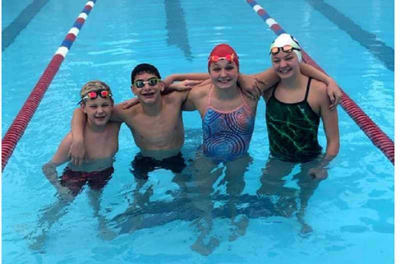 SUBMITTED PHOTO - Christopher Dankenbring, Colby Anderson, Lexi Williams and Elli Wlliams compete in the USA state meet.