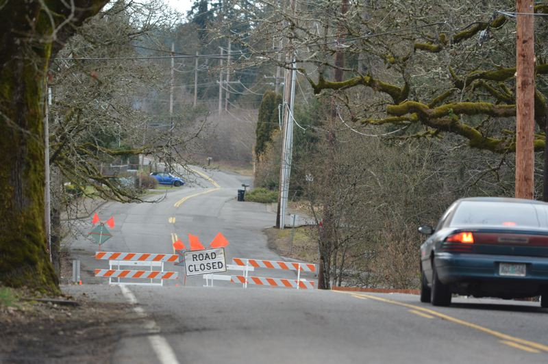 PMG PHOTO: COURTNEY VAUGHN - Cars hit an unexpected detour near a section of Gable Road near Firlock Park Street in St. Helens. A portion of the road remains closed until crews can repair asphalt damaged by heavy flooding in February.