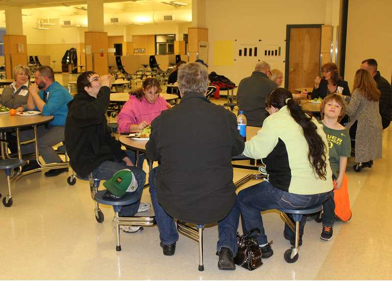 HOLLY M. GILL/MADRAS PIONEER - Community members and staffers sit down for dinner on Wednesday, Feb. 20, in the Madras High School commons for the Jefferson County School District Engagement Process.