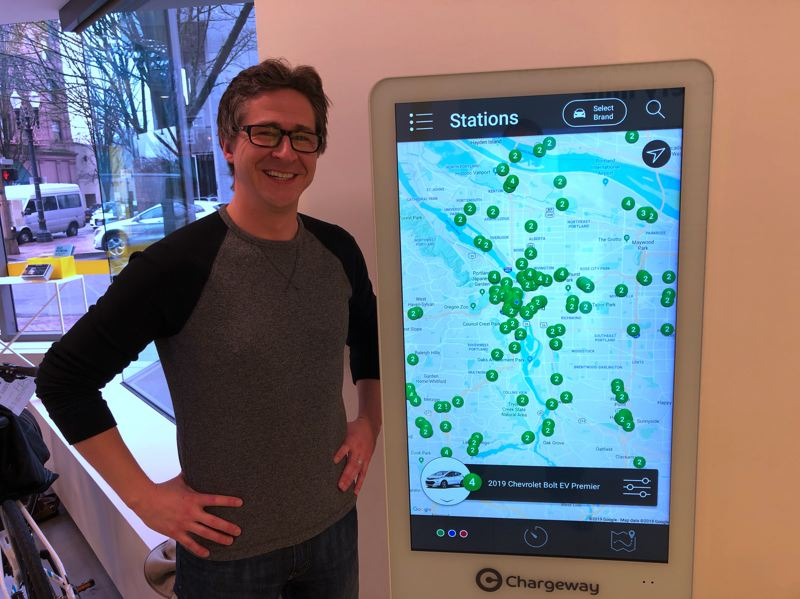 COURTESY CHARGEWAY - Chargeway founder Matt Teske in front of one of the beacon locators developed by hus company.