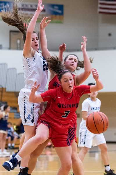 PMG PHOTO: CHRISTOPHER OERTELL - Liberty's Clara Robbins defends Westview's Josie Napoli during the Falcons' game against the Wildcats Thursday, Feb. 28, at Liberty High School.