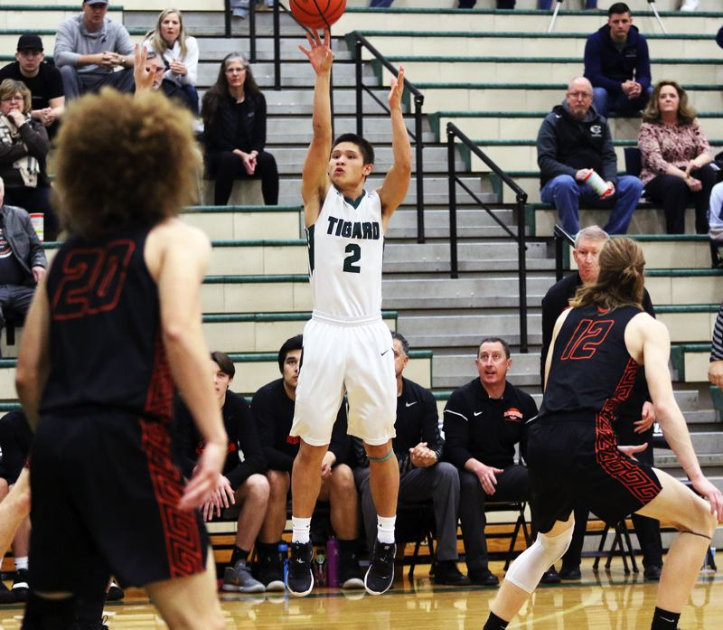 PMG PHOTO: DAN BROOD - Tigard senior Jazz Ross fires a jump shot during the first quarter of Thursday's Class 6A state playoff game.