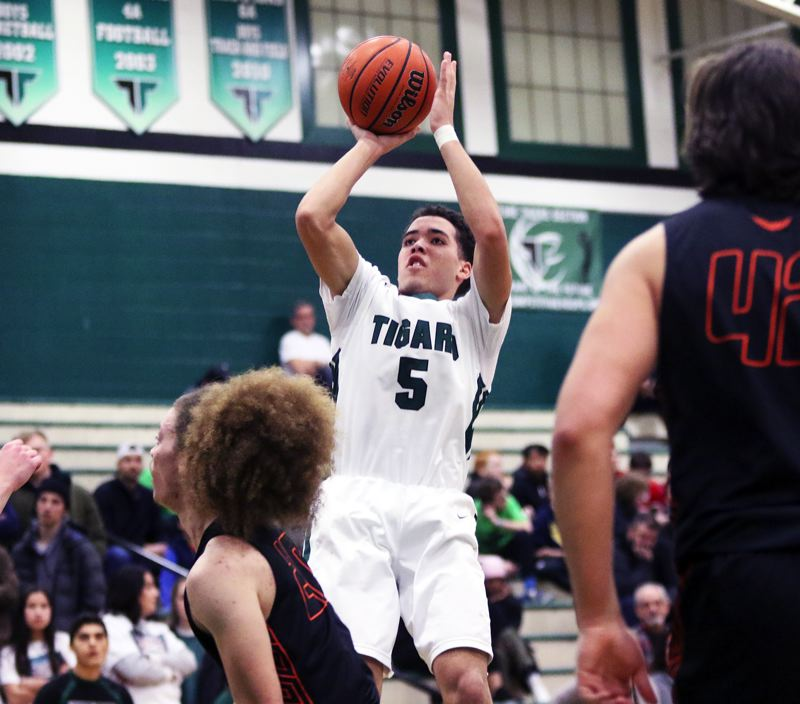PMG PHOTO: DAN BROOD - Tigard sophomore Drew Carter goes up for a jumper during the Tigers' state playoff win over Roseburg on Thursday.