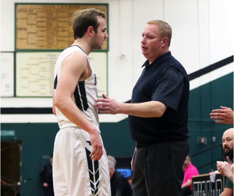 PMG PHOTO: DAN BROOD - Tigard coach Shawn Alderman talks to Tiger senior Stevie Schlabach during Tuesday's Class 6A state playoff game.