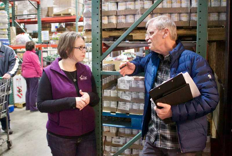 PMG PHOTO: CHRISTOPHER KEIZUR - Congressman Earl Blumenauer visited SnowCap Community Charities Friday morning, Feb. 22, getting a tour from Executive Director Kirsten Wageman.