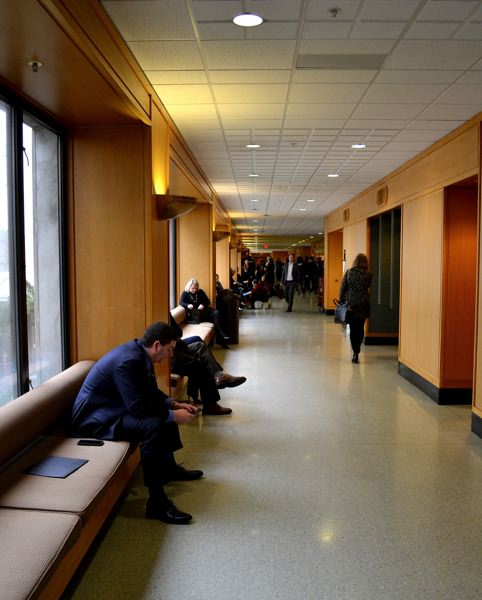 PMG PHOTO: PARIS ACHEN - Lobbyists wait outside Capitol hearing rooms during a recent busy day in Salem.