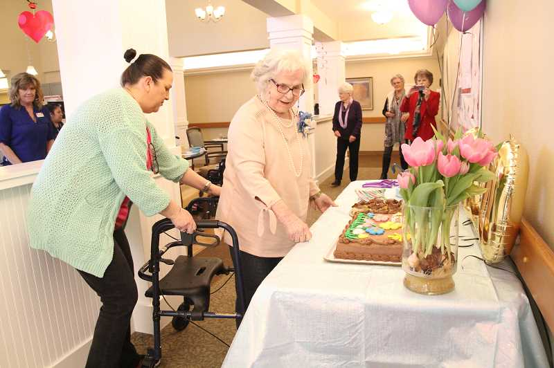 PMG PHOTO: JUSTIN MUCH - Maxine Reisbig, who turned 100 on March 2, celebrated the milestone at Heartwood Place on Friday.