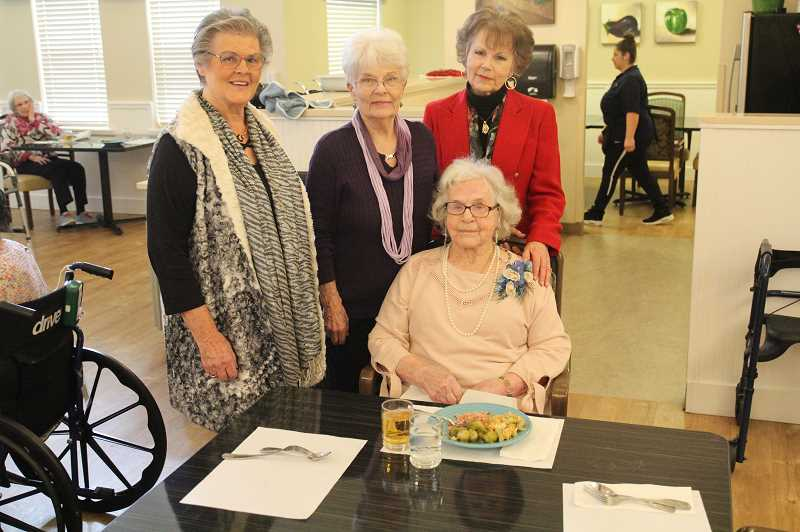 PMG PHOTO: JUSTIN MUCH - Centenarian Maxine Reisbig, sitting, celebrates with her nieces, left to right, Karen Flint of Stayton, Nina Schiermeister of Vancouver, Wash., and Flo Anderson of Woodburn.