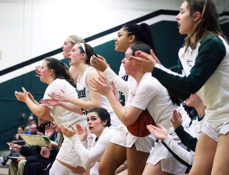 PMG PHOTO: DAN BROOD - Tigard players cheer following a late basket by sophomore Rachel Denham during Thursday's Class 6A state playoff game with McNary.
