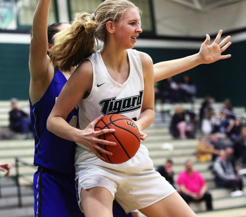 PMG PHOTO: DAN BROOD - Tigard freshman post Sarah Lamet controls the ball inside during the Tigers' Class 6A state playoff win over McNary.