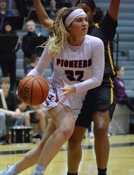 PMG PHOTO: DAVID BALL - Oregon Citys Katie Kathan drives the baseline looking for a passing option in the second half of the Pioneers 54-47 playoff loss to Roosevelt on Thursday.