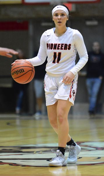PMG PHOTO: DAVID BALL - Oregon City guard Tyra Bradford brings the ball over halfcourt during the second half of the Pioneers 54-47 playoff loss to Roosevelt on Thursday.