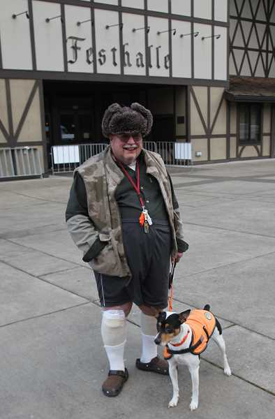 PMG PHOTO: JUSTIN MUCH - George Morgan of Canby and his basenji-rat terrier mix, Hassenpfeffer, were among the early comers to enjoy the 11th Annual Mount Angel Volksfest Friday, March 1.
